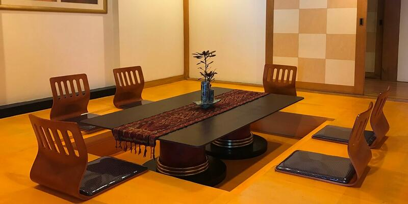 Tatami room with a low table and chairs