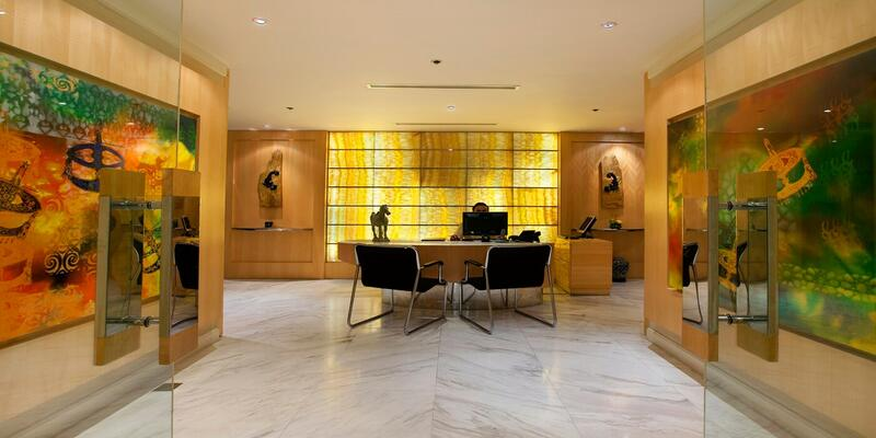 Main entrance of club lounge with paintings at the side