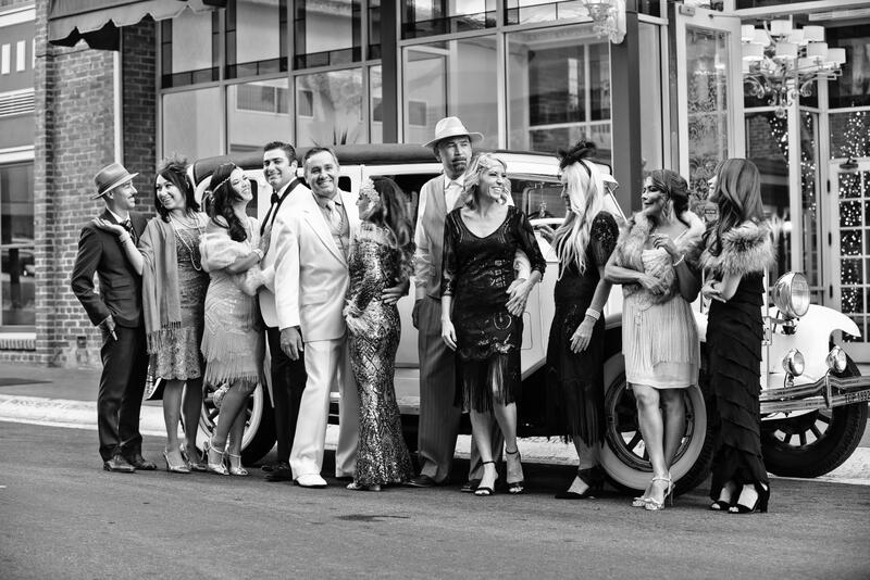 wedding party in front of vintage car