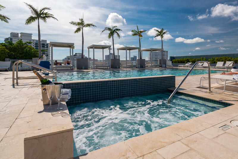 rooftop pool and jacuzzi with cabanas and lounge chairs