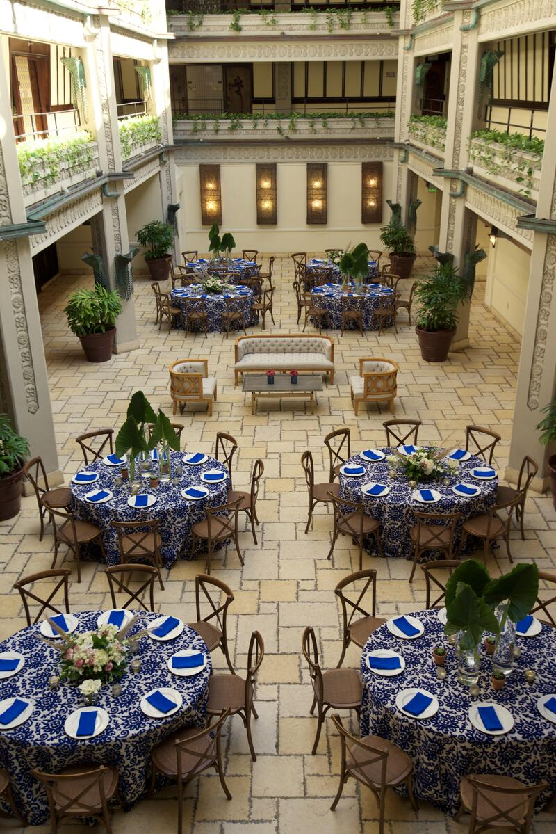 outdoor courtyard with round dining tables