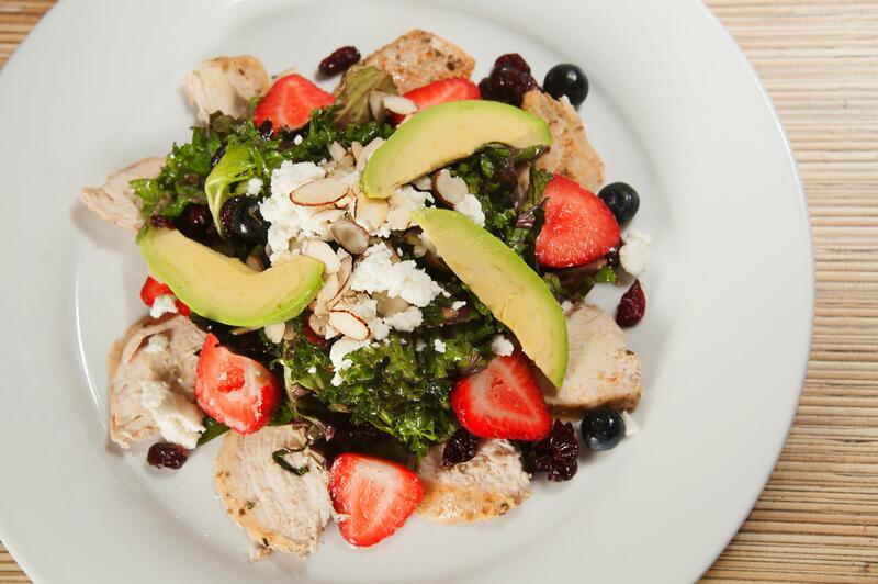 Chicken salad with avacado slices and fruit