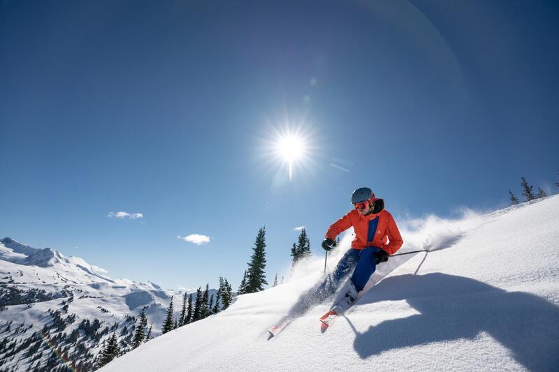 skiier in red jacket on slope