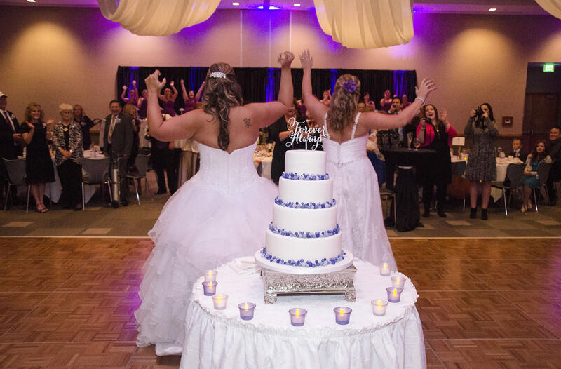two brides dancing at their wedding