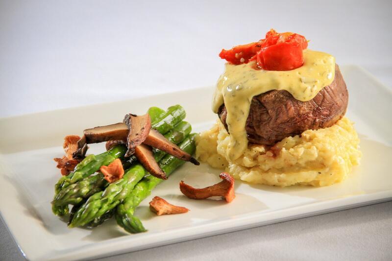 fancy dinner entrée with steak, potatoes and asparagus