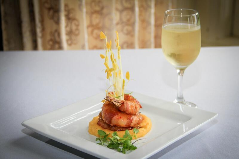 fancy dinner entrée paired with white wine