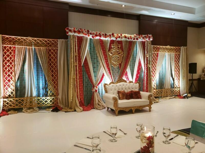 banquet hall with white and gold seating bench and decorative dr