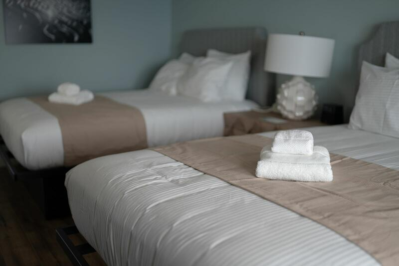 two beds with clean folded towels
