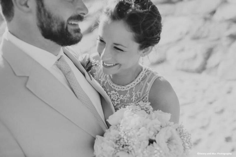 a bride holds her groom and laughs