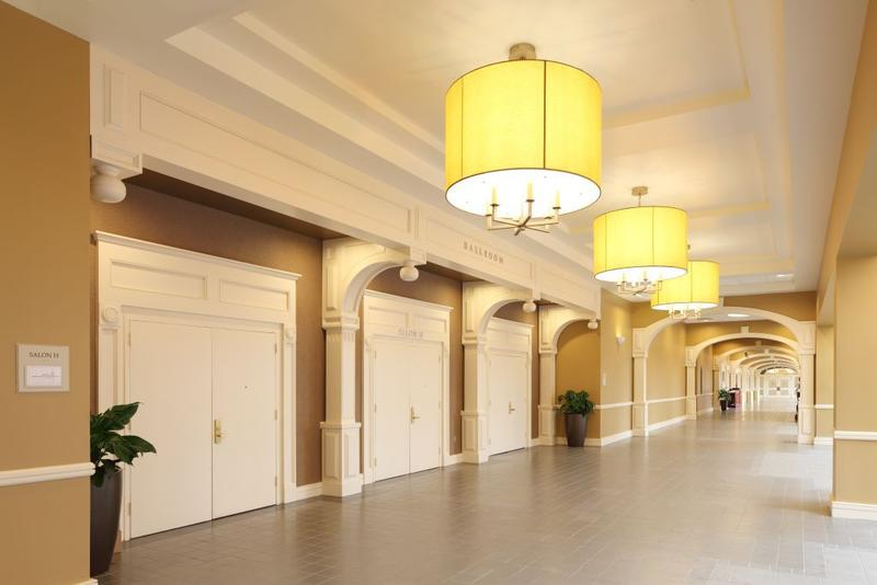 hallway with entrances to conference rooms