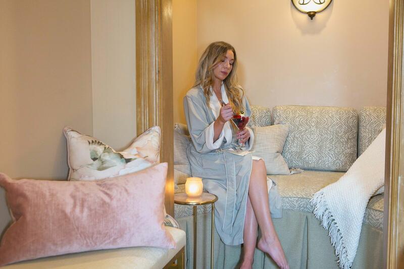 woman in bath robe eating a parfait