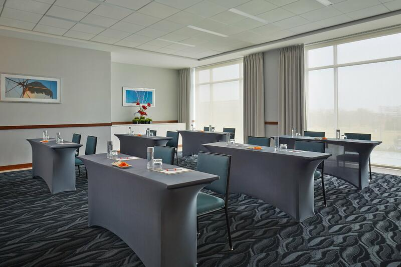 Tall tables and chairs in a meeting room