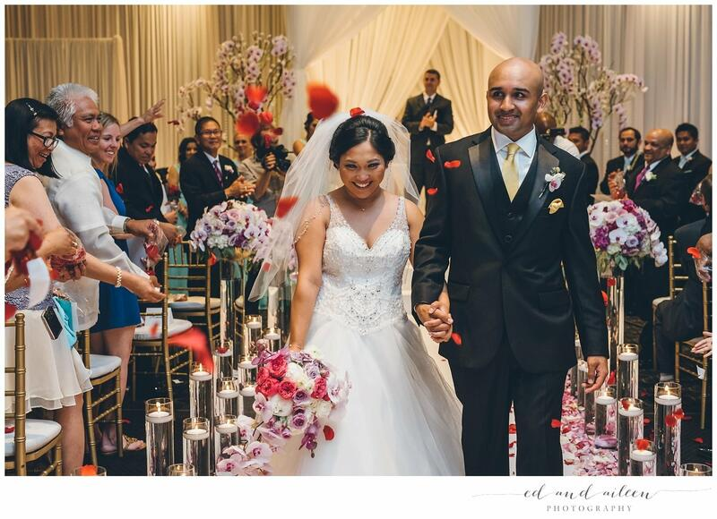 a bride and groom walk down the isle