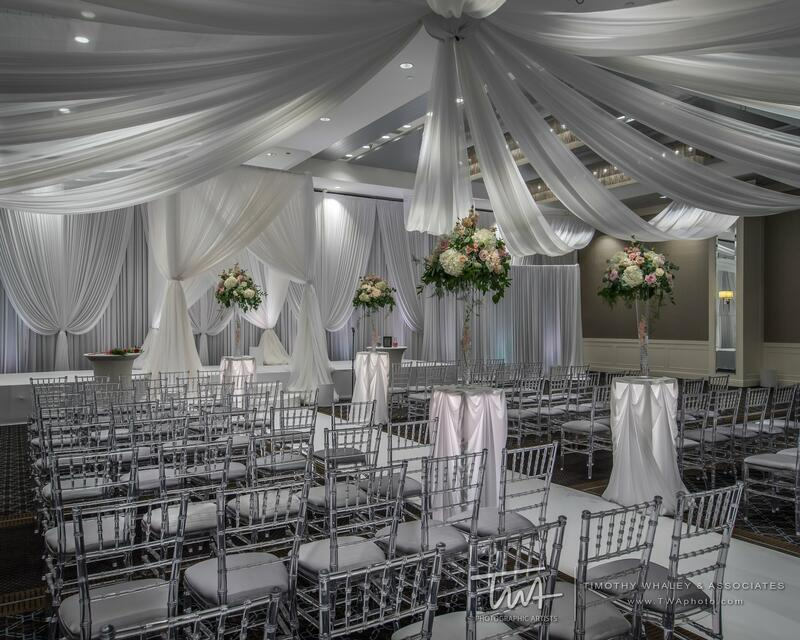silver chairs in a decorative wedding reception
