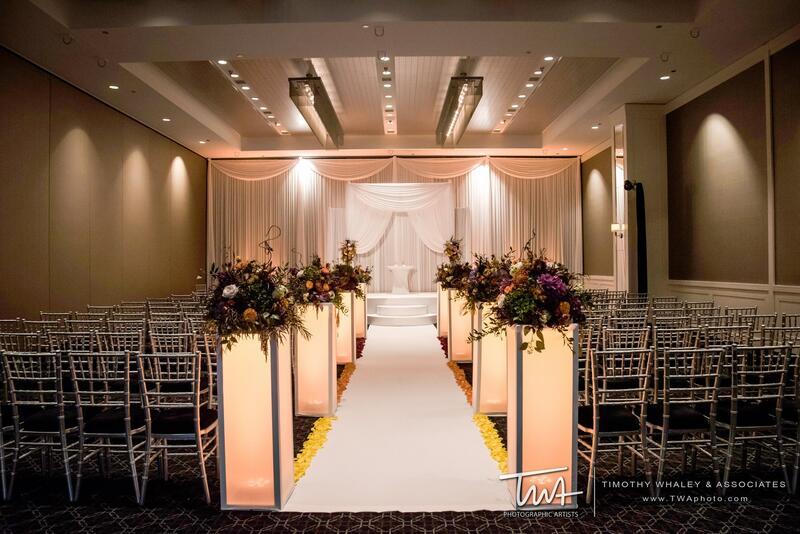 glowing pillars light a wedding reception