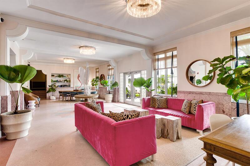 lobby with velvet pink sofas near windows