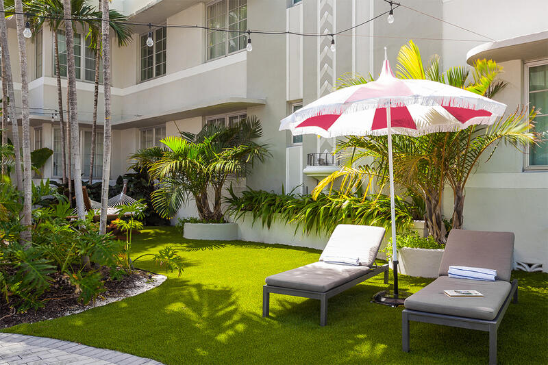 garden area with lounge chairs and umbrellas
