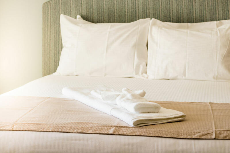 clean towels on a hotel bed