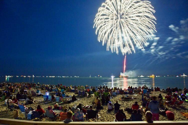 Crowds gathered to watch fireworks over the water