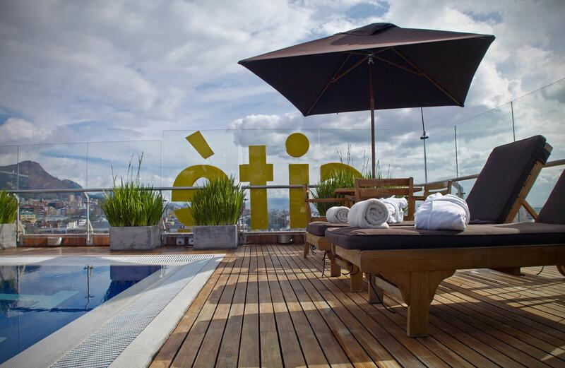rooftop pool seating during day