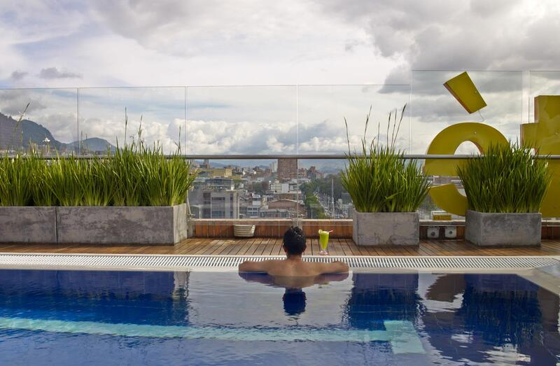 man in pool looking at city