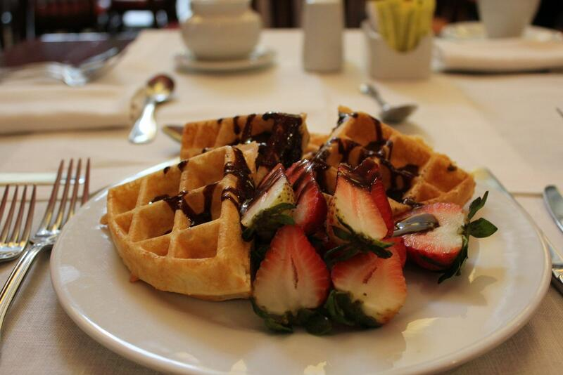 waffles with drizzled chocolate and strawberries