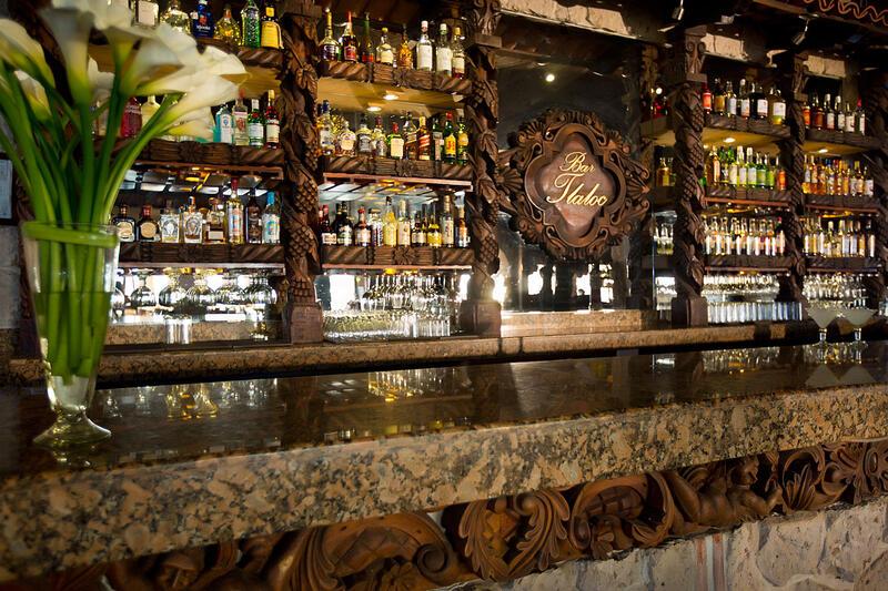 bar with liquour bottles on shelf