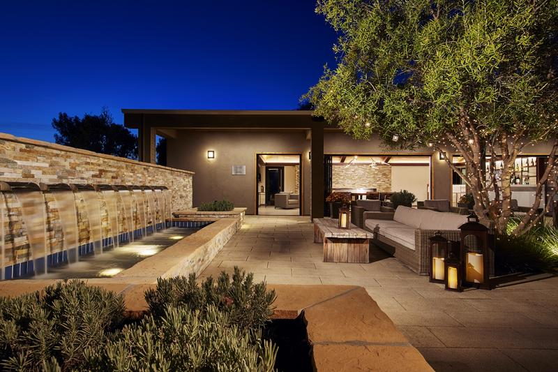outdoor gathering area with a water feature