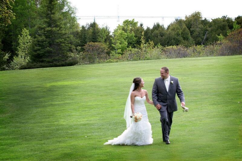 bride & groom on lawn