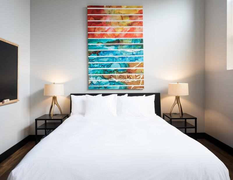 bed with colorful artwork