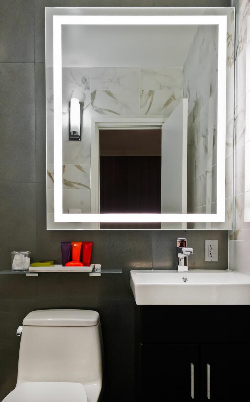 large mirror above a bathroom sink