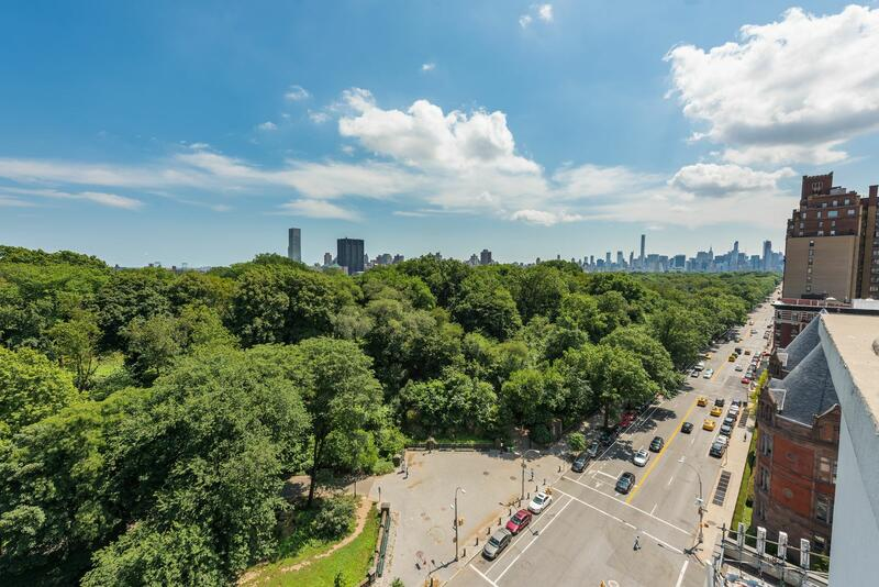 cars driving past central park in New York City