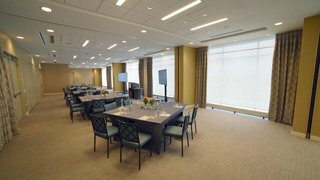 a spacious event room with tables and chairs
