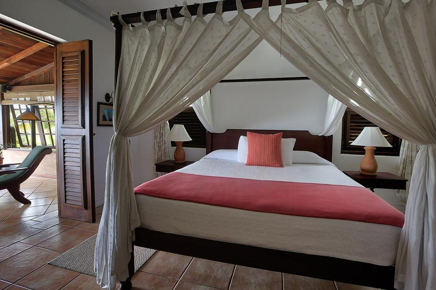 large bed in tropical villa