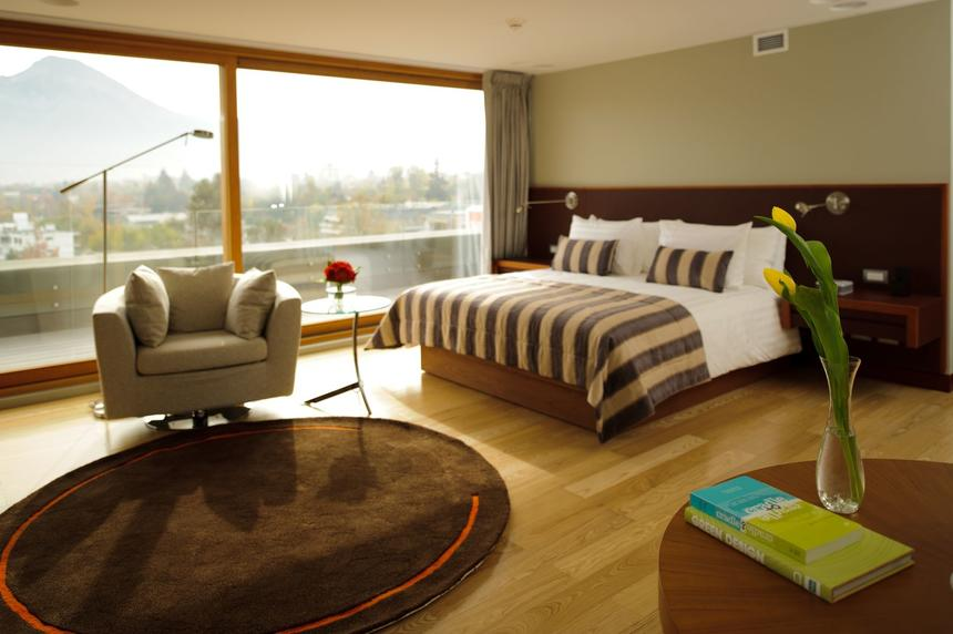 Terrace Suite bedroom with king size bed at NOI Vitacura hotel