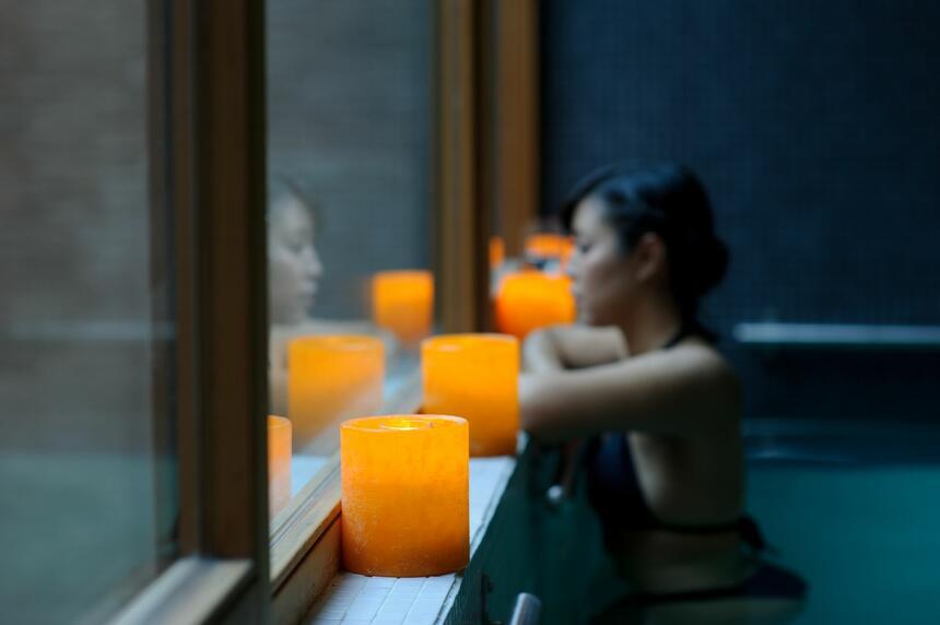 Woman at the Pool & orange candles at NOI Vitacura hotel