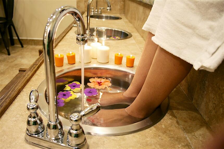 person getting foot bath