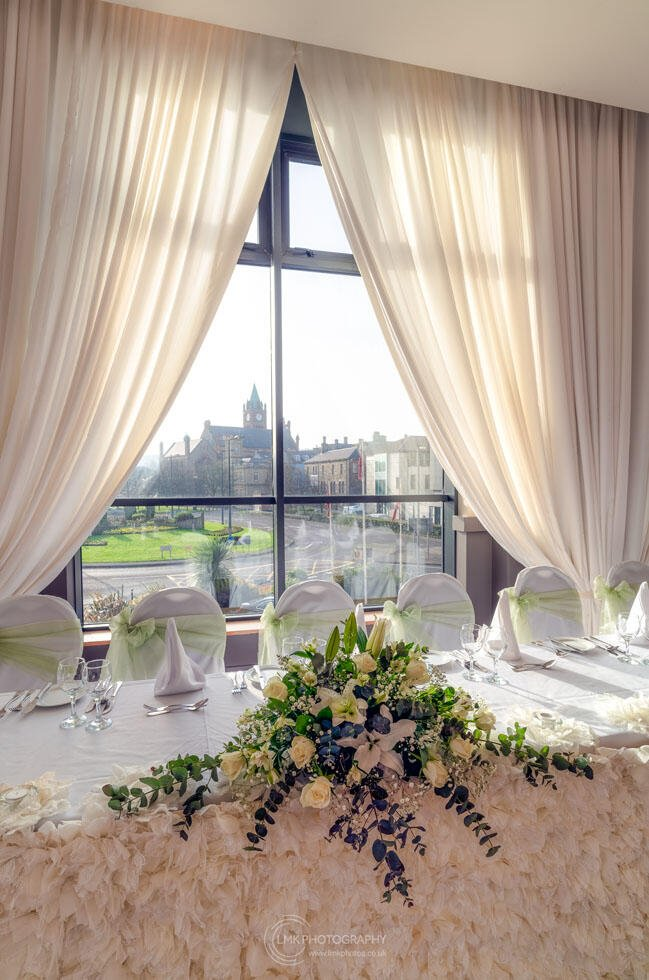 City Hotel Derry Ballroom Showing Flower Arrangement On Bride An