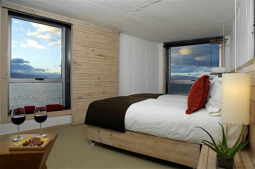 Bedroom with a king bed & ocean views at NOI Indigo Patagonia