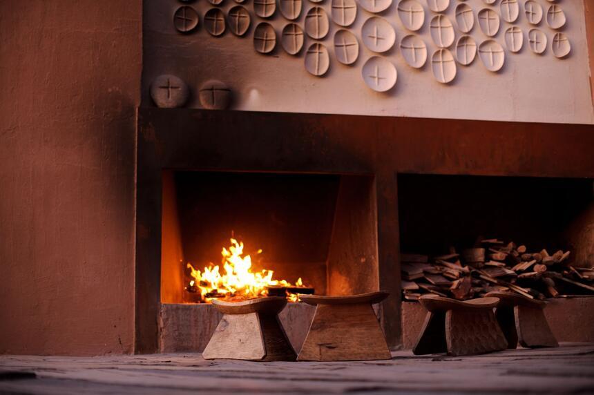 A fire place and setting area at NOI Casa Atacama Hotel