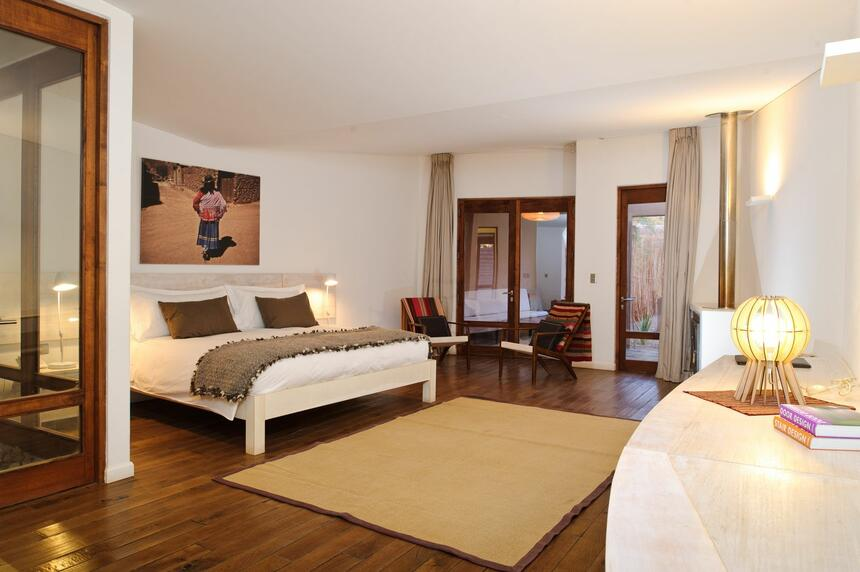 NOI suite room with king sized bed  at NOI Casa Atacama Hotel