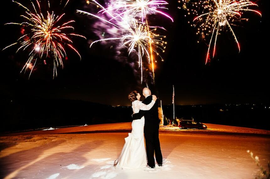 bride and groom under fireworks
