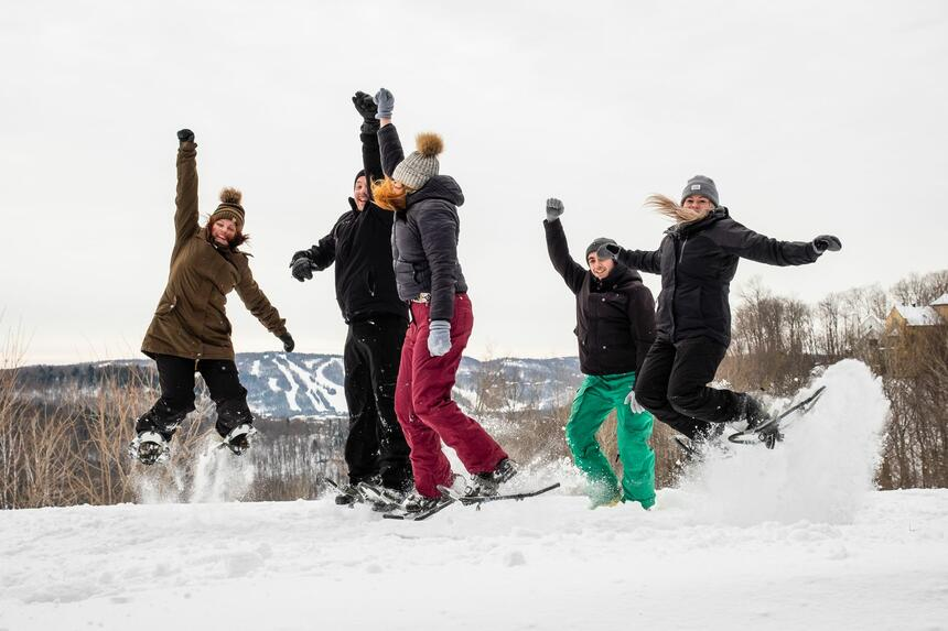 Group of people having fun snowshoeing