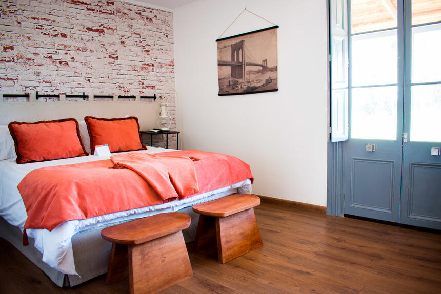 close up on a bedroom with king bed at Noi Blend Colchagua