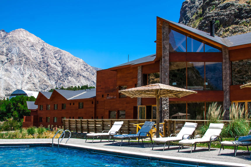 side view of pool & hotel exterior at NOI Puma Lodge Hotel