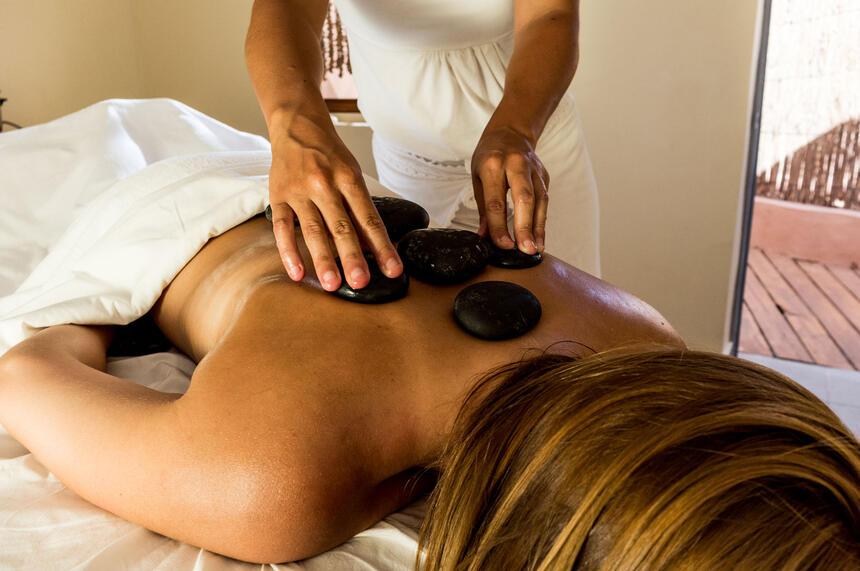 hot stones treatment on women at NOI Casa Atacama hotel