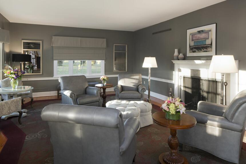 living room with gray furniture