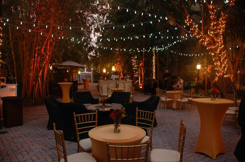 outdoor patio with tables and lights