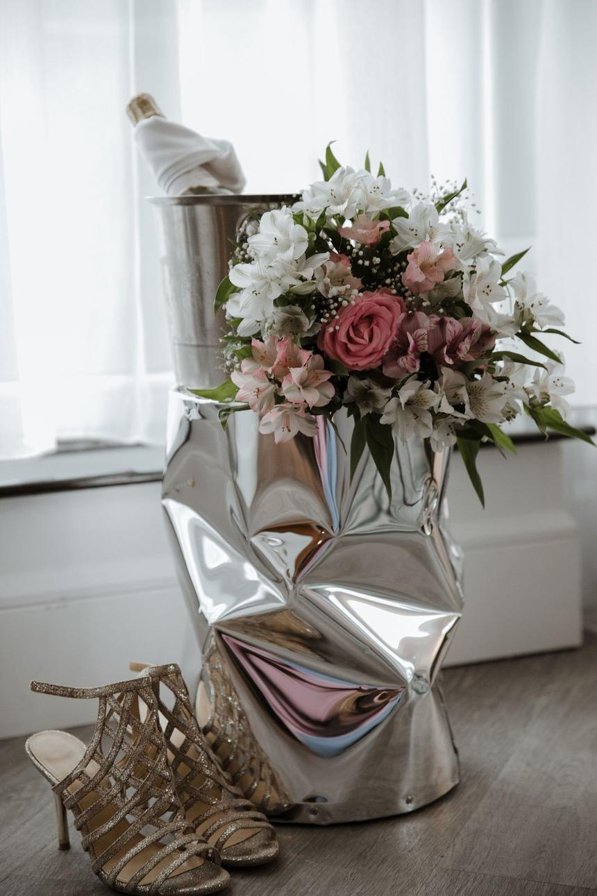 Detail shot of wedding shoes & bouquet