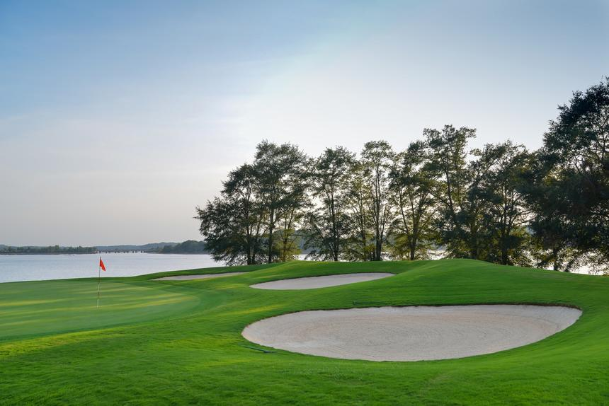 golf course with lake in background